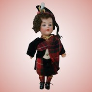 9-1/2 In. German Gebruder Heubach Character Doll, Completely Original in Scottish Costume, Glass Eyes, Molded Tongue, Mold #7560 ?