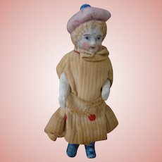 3-1/4 In. Early German All Bisque Child Doll with Painted Eyes, Stiff Hips, Bootines, Stockings, Garters, Molded Hat