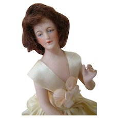 9 Inch German Bisque Wigged Lady on Original Porcelain Tube-like Body with Feet, Dressed Originally