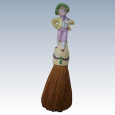 "8 Inch Whisk Brush with a Porcelain Full Figure of a Young Lad as Handle; "" Made in Germany """