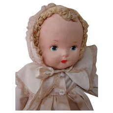 16-1/2 In. Musical / Lullaby Cloth Masked Face Baby Doll with Big Blue Eyes, Original Clothing, Matching Coat and Bonnet, So Sweet