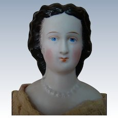 1860's 14 Inch Un-Tinted Bisque Shoulder Head or Parian-Type Doll with Lovely Black Fancy Hairdo, Decorated Shoulder Plate