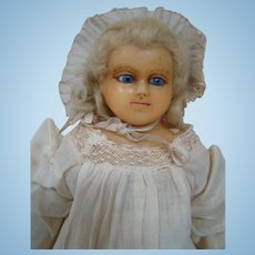 14.5 In. English Wax Shoulder Head Child Doll, Blue Glass Eyes, Set-in Mohair in Curls, Cloth Body, Wax Lower Arms and Legs,