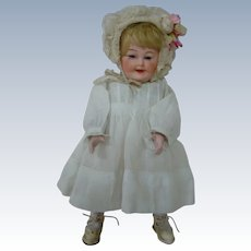 Unusual and Rare Wind-Up Mechanical Toddler Using RARE Character Bisque Head by Gebruder Heubach.  Works Great!