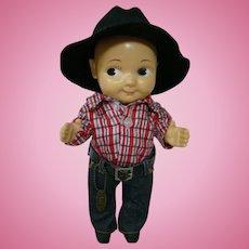 13 In. Original Hard Plastic Cowboy Wearing Lee Jeans, Red Plaid Flannel Shirt and Black Felt Hat, ca:  1949-1962