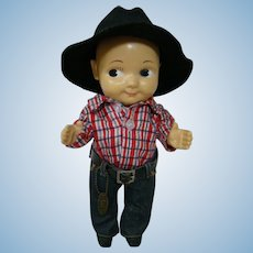 13 In. Original Hard Plastic Cowboy Wearing Lee Jeans, Red Plaid Flannel Shirt and Black Felt Hat, ca:  1949-1962