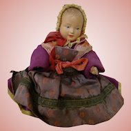 7 In. Beautiful French All Celluloid Baby in Elegant Original Brocades and Silks and Beaded Bonnet