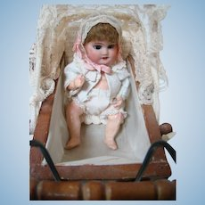 7 In. French S.F.B.J. Bisque Head Baby in Vintage German Wood Buggy