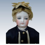 22 In. Early French Bisque Fashion Doll in Excellent Condition with Firm Original Leather Body