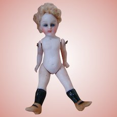 All Bisque with Glass Eyes, Wire-Jointed Shoulders & Hips, Closed Mouth, High Black Stockings and Brown Shoes