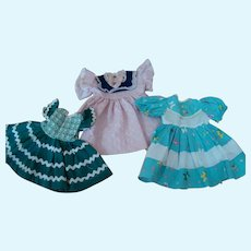 3 Original Clean and Crisp Factory Dresses for Hard Plastic Dolls