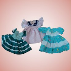 3 Original Clean and Crisp Factory Dresses for Hard Plastic Dolls