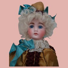 Large Antique Musical Twirling Toy with Beautiful Closed Mouth Bisque Head in Silk Costume