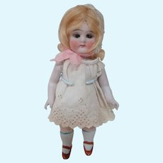 7 In. German All Bisque with Glass Sleep Eyes, Jtd at Shoulders and Hips, Closed Mouth, Wigged