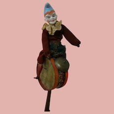 Mechanical Clown Seated on Drum or Tambourine, Clanging Cymbals with Legs and Arms Movement