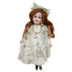 6.5 In. German Bisque Head Kuhnlenz Child Doll on Quality Five-Pc Composition Body