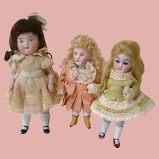 Three Cute German All Bisque Girls, Size 4-4-1/2, Glass Eye and Painted Eye,  Pink Boots, Wigs