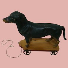 17.5 In. Antique Paper Mache Dachshund Dog on Wheels Pull Toy, Glass Eyes