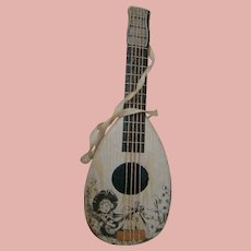 Doll Size Candy Container a la Lithographed String Instrument, Made in Germany