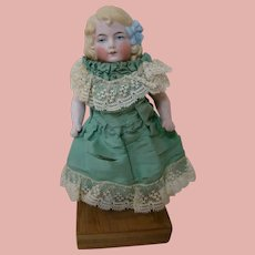 6 In. Early German All Bisque, Molded Hair with Blue Bow, Painted Eyes, Wire Jointed