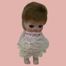 3-3/4 In. German All Bisque Toddler, Jointed Arms, Glass Eyes, Mohair Wig, Closed Mouth