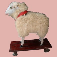 Antique Wooly Lamb on Metal Wheel Platform