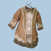 Two Piece Antique Silk Brocade Lace-Trimmed Jacket with Bustle and Solid Skirt with Knife Pleats and Lace