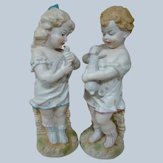 13 In. Pair of German Bisque Child Figurines Holding Their Pets, Gebruder Heubach Quality
