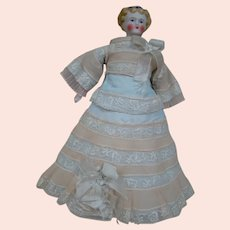 Petite 9-1/2 In. Parian Type Doll on Original Cloth Body, Bisque Lower Arms and Legs with Black Heeled Boots, Blue Hair Bow