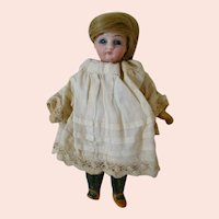 5-1/4 In. German Swivel Neck, Glass Eye, Closed Mouth Doll in Original Clothes, Great Wig!