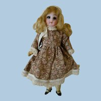 5-1/2 In. Swivel Neck German Bisque Head Doll, Closed Mouth, Glass Eyes, Original 5-Piece Composition Body, Mohair Wig, Bonnet