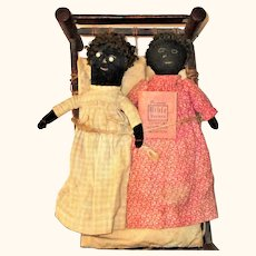 Two 19th Century Black Cloth Dolls in Primitive Bed
