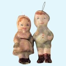 Pair 3 Inch Wax Over Composition Hatted Toddler Figures with Hanging Loops