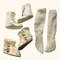 2 Pair Soft Ivory Kid Boots and a Pair of Stockings