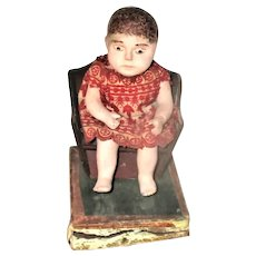 Scarce 19th Century 6 Inch Painted Chalk Toddler on Wood Commode Chair Squeak Toy Wear & Loss