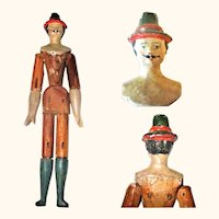 Scarce Early 19th Century 6 Inch Grodnertal Doll House Man Vibrant Gesso Face Carved Hat Long Blue Stockings