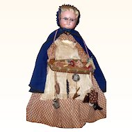 19th Century 21 Inch Wax Over Composition Peddler Woman Doll Basket Wares Cloak Woven Straw Bonnet Spectacles