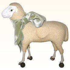 Antique German Flannel Covered Sheep on Wheels Painted Wood Legs Hoofs Green Glass Eyes Working Squeak Mechanism