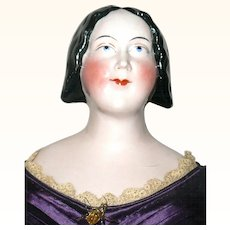 20 Inch 1840's Pink Tint A W Kister China Lady with Coiled Bun and Spaniel Ears Hairdo Linen Body Leather Arms