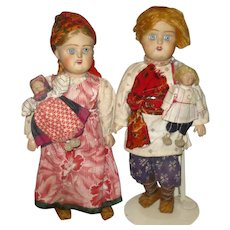 Girl and Boy 11.5 Inch  Pair of Russian Low Fired Bisque Dolls Holding Matching Tiny Dolls