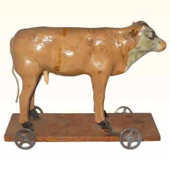Old Caramel Painted Plaster and Wood Cow on 5.5 Inch Wheeled Platform