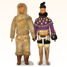 Pair Labeled 15 Inch Greenland Carved Wood Inuit Dolls in Traditional Costume