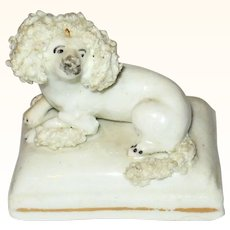Tiny 1845 Woolly White Poodle Reclining on Gold Striped Base
