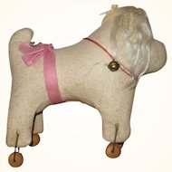 Primitive Hard Stuffed Flannel Dog on Wood Wheels Glass Eyes Remnants of Fur Ears