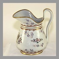 Vintage white porcelain pitcher with hand painted crest and gold trim