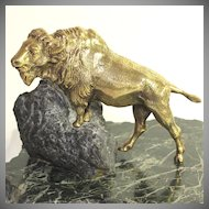 Wonderful gilded bronze sculpture of a buffalo on a rock