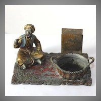 Interesting 19th c cold painted Austrian sculpture, pipe holder of a man on a rug