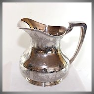 Large silver plate pitcher/jug with engraved Dutch scenes