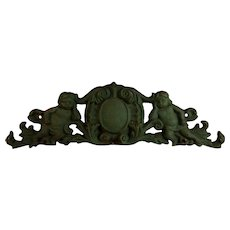 Vintage Cast Iron Pediment Overdoor with Putti and Shield