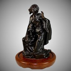 Bronze Sculpture of a Cloaked Woman on One Knee
